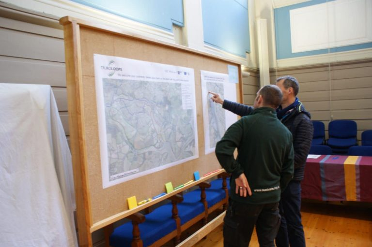 Public looking at Truro Loops map