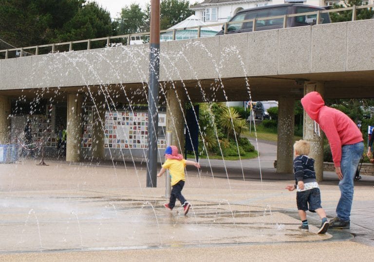 Children and grown ups getting out and active by enjoying a water feature at Bournemouth Pier
